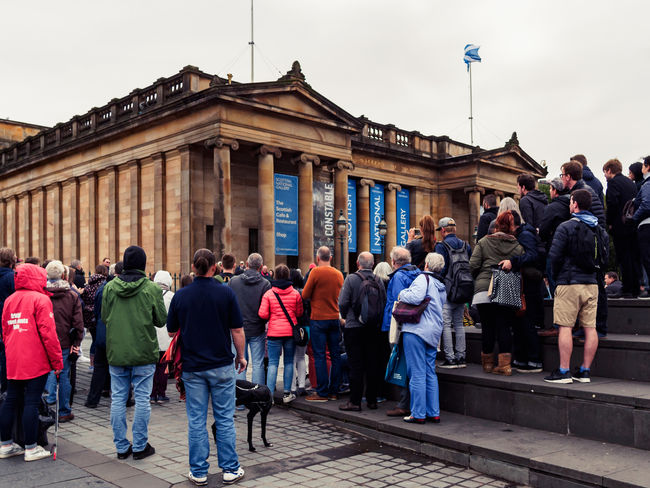 Edinburgh, Scotland National Gallery  People Watching Saltire Spectators Tourists Watching A Performance Building Exterior Crowd Fascination Interest Intriguing Large Group Of People Looking Outdoors People Real People Street Scene Streetphotography Tourism Travel Destinations