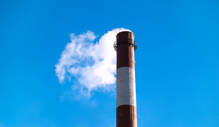 Low Angle View Of Factory Chimney Against Clear Sky