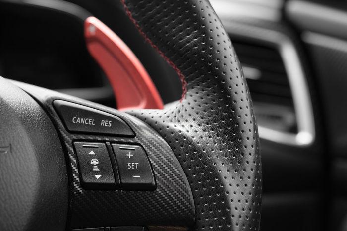 Car Interior. Steering wheel in modern car Button Cruise Control  Leather Modern Switch Adjust Car Dashboard Design Drive Horn Limit Speed Luxury Paddle Shift Radar Sport Car Steering Wheel Vehicle Interior