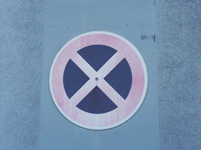 No Stopping Sign On Blue Wall