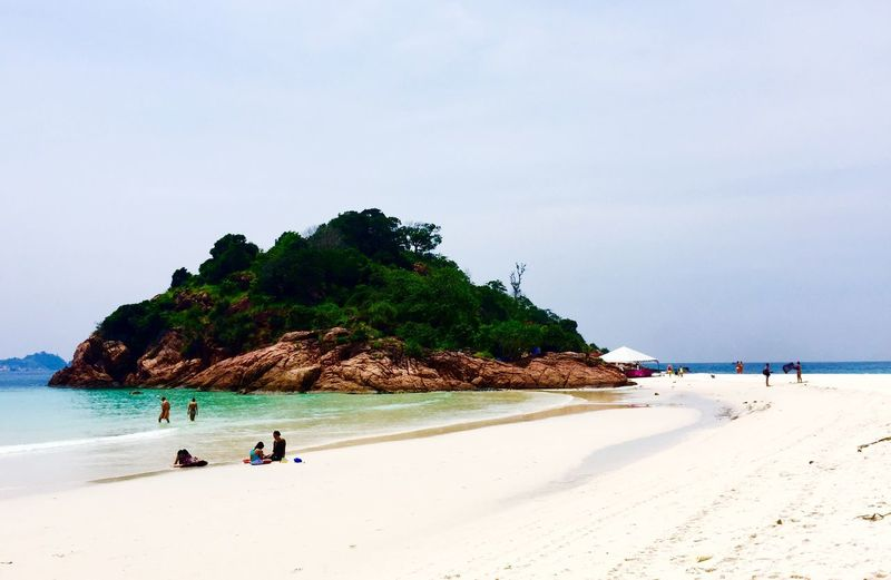 Sea Beach Sand Water Shore Nature Scenics Beauty In Nature Horizon Over Water Rock - Object Tranquil Scene Tranquility Vacations Outdoors Day Sky Real People Cliff Full Length Travel Destinations Malaysia