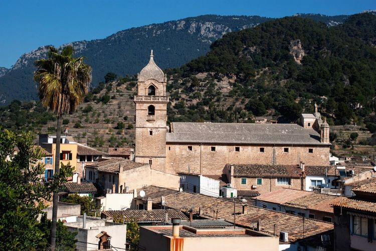 Bunyola, Mallorca Houses Hill Village Spanish Balearic Islands Mallorca SPAIN Bunyola Church Architecture Built Structure Building Exterior Building Tree Plant Religion Mountain Place Of Worship No People Tower Day
