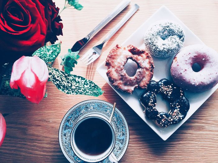 Directly Above Shot Of Black Coffee And Donuts On Table