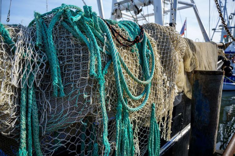 Fishing net on pier at harbor