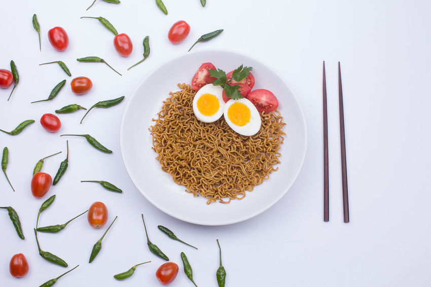 Fried noodle on a white plate styled beautifully Fried Noodles Noodles Breakfast Directly Above Egg Food Food And Drink Freshness Healthy Eating High Angle View Indoors  Meal No People Noodle Plate Ready-to-eat Serving Size Still Life Studio Shot Table Temptation Vegetable Wellbeing White Background