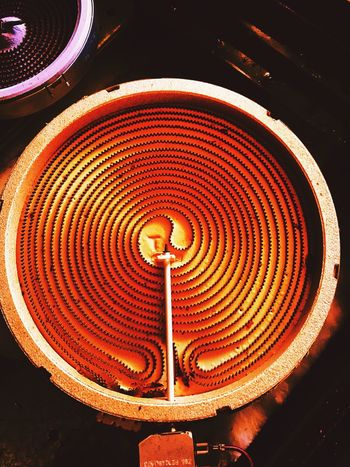 Metal Circle Circular Pattern Electrical Heating Element Close-up No People High Angle View Glowing Glowing Heating Element Metal Structure Electrical Component Heat Amber Glow Electric