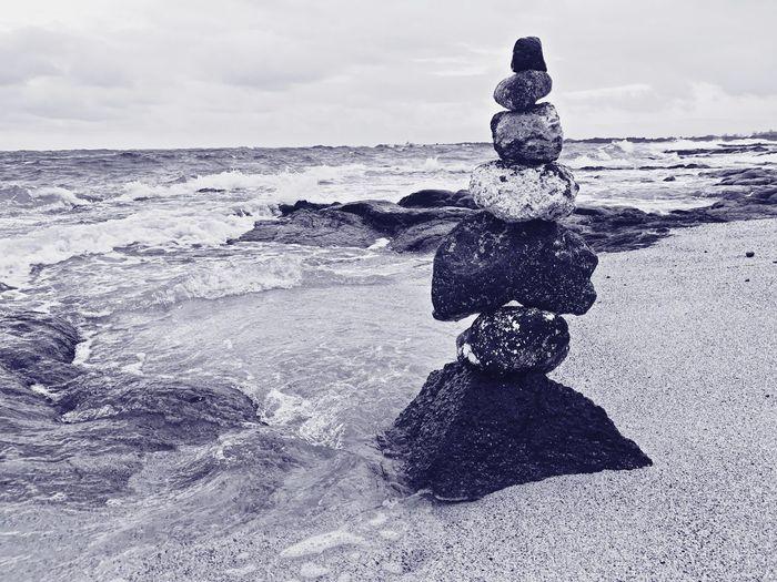 Sculpture On Beach Against Sky