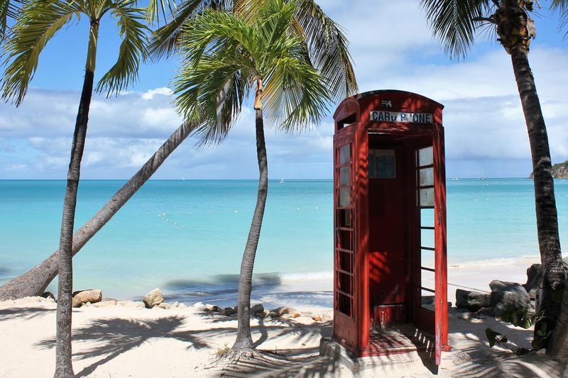 Red public telephone booth on Antigua Red Phone Boxes Red Phone Box Beach Beauty In Nature Day Horizon Over Water Nature No People Outdoors Pay Phone Payphone Payphone On Every Corner Payphone Telephone Payphones Of The World Phone Booth On Antigua Public Payphone Red Red Phone Red Phone Booth Red Phone On Antigua Red Phonebooth Red Phonebox Sea Sky