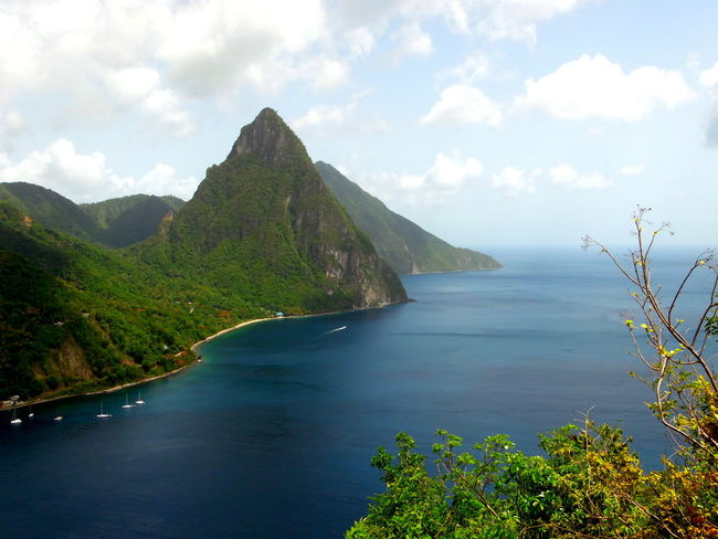 This picture is of the the Gros Piton in Soufriere, St.lucia. Beauty In Nature Caribbean Nature's Diversities Coastline Geology Hill Majestic Mountain Mountain Range Mountain View Mountains Ocean Ocean View Outdoors Rock Rock Formation Rock Formation Scenics Sea Seeing The Sights Tranquil Scene Tranquility Trip Voyage Water