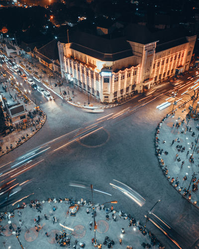 High angle view of people on city street at night