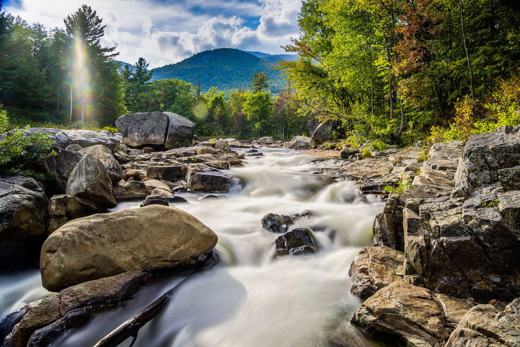 Near White Face Mountain Beauty In Nature Clouds Flowing Flowing Water Forest Light Long Exposure Mountain Nature Non-urban Scene Outdoors Rock - Object Stone Stream Tranquility Water