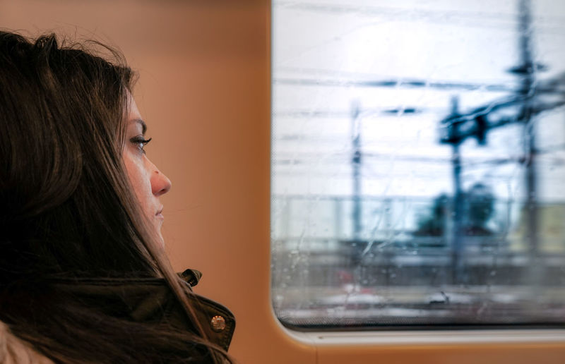 Sad woman Loneliness Lonely Travel Woman Young Close-up Day Headshot Indoors  Lifestyles Looking Through Window Melancholy One Person People Real People Sad Sad & Lonely Sad Face Sadness Side View Train Transportation Window Young Adult Young Woman