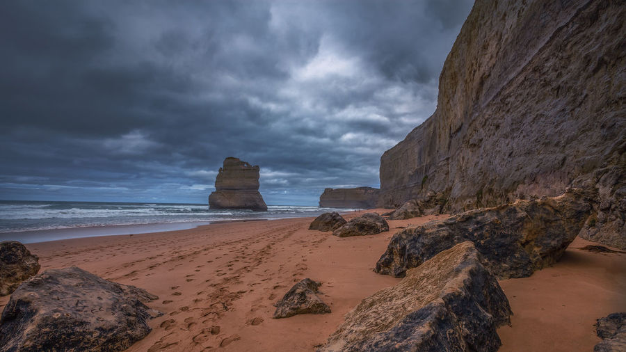 Gibson Steps against cloudy sky Australian Landscape Great Ocean Road, Australia National Park Beach Beauty In Nature Cloud - Sky Eroded Horizon Over Water Land Nature Non-urban Scene Outdoors Overcast Rock Rock - Object Rock Formation Sand Scenics - Nature Sea Sky Solid Storm Cloud Tranquil Scene Tranquility Water