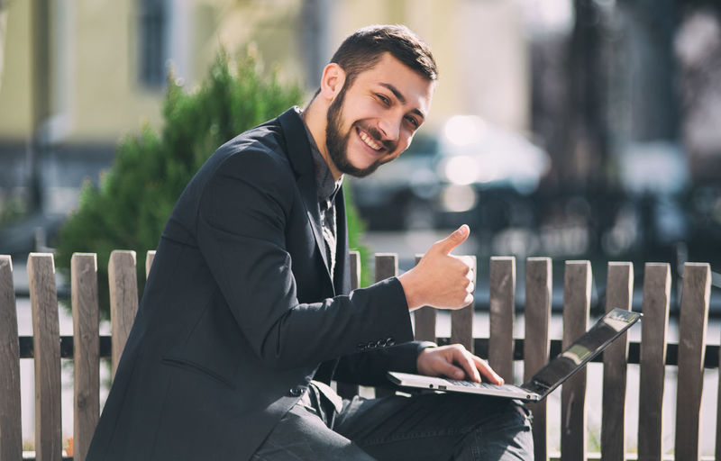 Three Quarter Length Business Person Businessman One Person Young Adult Business Men Focus On Foreground Well-dressed Formalwear Suit Smiling Portrait Males  Adult Sitting Young Men Looking At Camera Corporate Business