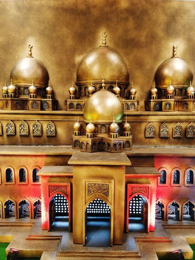 Illuminated Gold Colored Ornate Arch Architecture Built Structure Sculpture Sculpted Dome Human Representation Architectural Design Buddha Virgin Mary Cathedral Idol Place Of Worship Angel Golden Color Architecture And Art Mosque Carving - Craft Product Carving Statue Ceiling Mosaic Chandelier