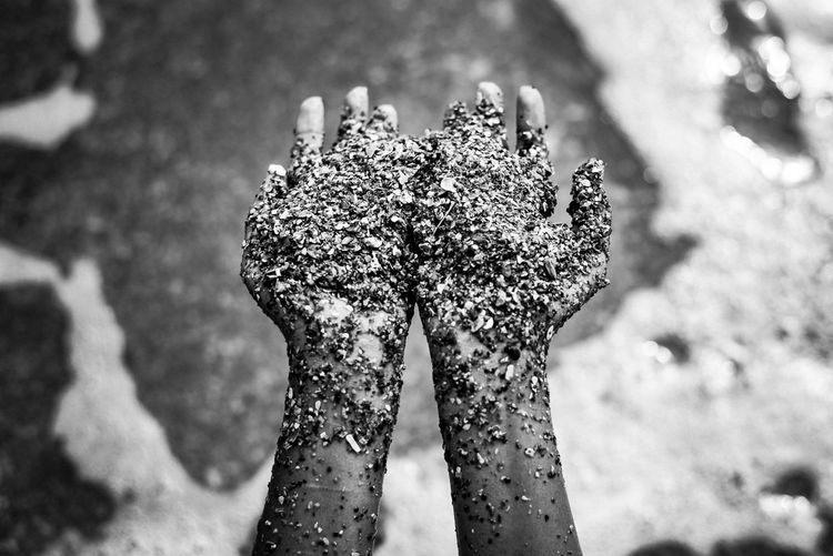 Close-up of woman holding sand