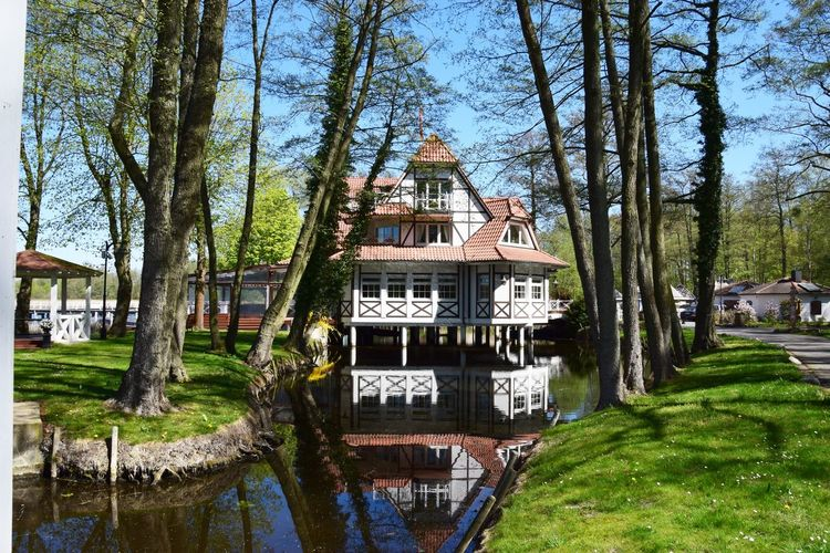 Ein Besuch in der Seelodge Kremmen... Architecture Built Structure Tree Water Building Exterior Plant Day Nature No People Building Reflection Travel Lake Outdoors Travel Destinations Text Communication Waterfront Park