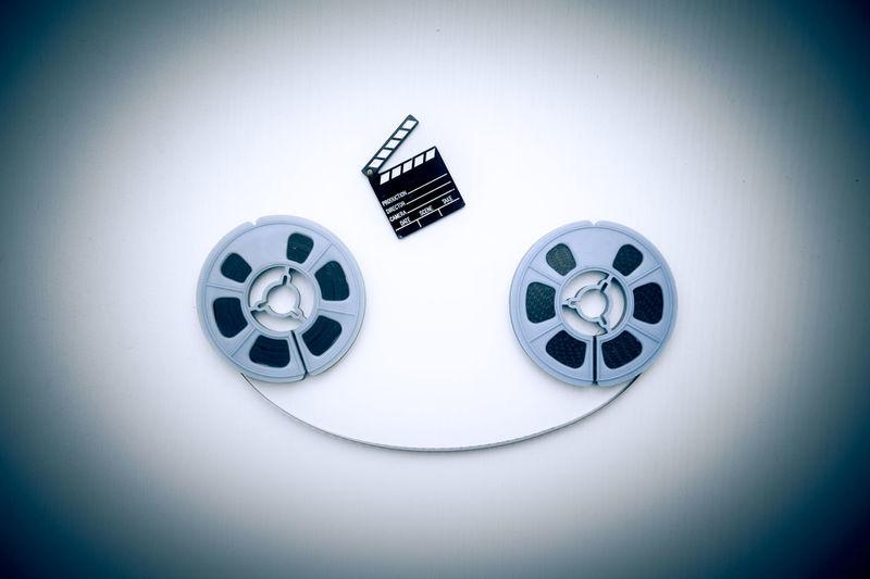 Super 8 movie reels and little clapperboard on white Cinema Clapboard Clapper Clapperboard Film Filmstrips MOVIE No People Reel Reels Studio Shot Super 8 Symbol