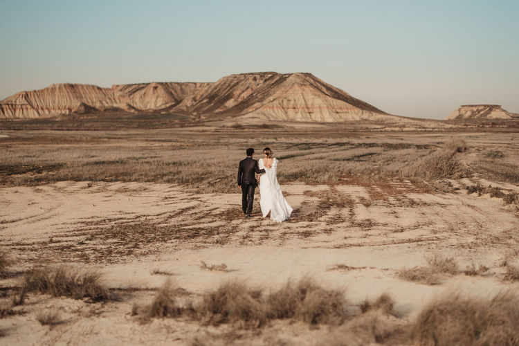 Rear view of couple kissing in desert