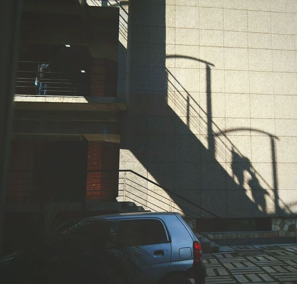 If u look at the shadow , you can see it as a stairway to the corridor and people are climbing it Car Transportation Shadow The City Light Built Structure Outdoors Day Architecture Light And Shadows Light Effect Enjoying The Sun Conceptual Photography  Concept Experimental Photography Flying High The Secret Spaces The Street Photographer - 2017 EyeEm Awards Break The Mold Rethink Things Mobility In Mega Cities