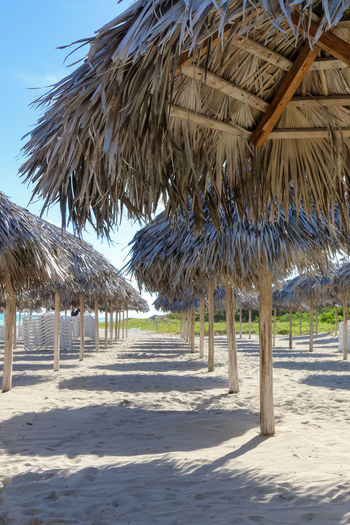Umbrellas on the empty beach, Cuba, Varadero Cuba Cuba. Varadero Varadero Beach Day Nature No People Outdoors Resort Sand Sea Shadow Shore Sunshade Umbrella Vacation Vacations