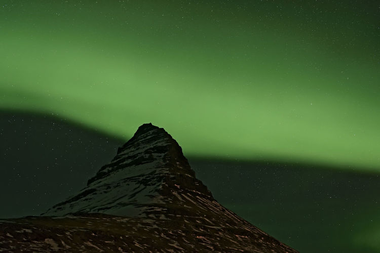 Spectacular Northern Lights around Kirkjufell mountain Aurora Borealis Green Color Iceland Impressive Northern Lights Polar Lights Spectacular Spirituality Amazing Arctic Lights Colorful Curtains Of Light Eco Tourism Electric Storm Ionosphere Magnetic Show Magnetosphere Mystical Night Sky Oxygen Solar Wind Space Weather Surreal Travel Destinations Vibrant Colors