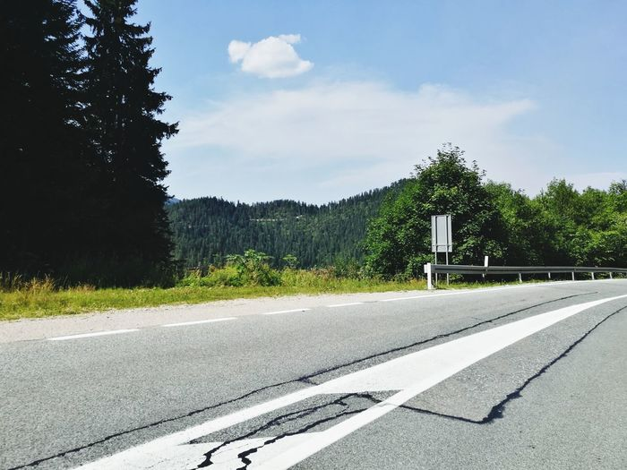 Road Road Marking Tree The Way Forward Cloud - Sky Sky Asphalt Outdoors Piece Of Heaven Driving Landscape Nature Journey Travel Mountain Range Forest