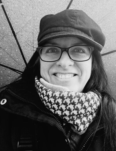 laughing in the rain Umbrella Bnw_friday_eyeemchallenge Bnw_expression Long Hair One Person Adults Only Portrait Real People Young Adult Headshot One Woman Only Only Women Looking At Camera Eyeglasses  Outdoors