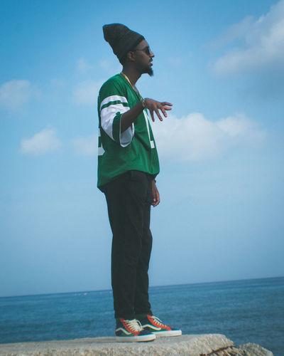 Full length of man standing near sea against sky