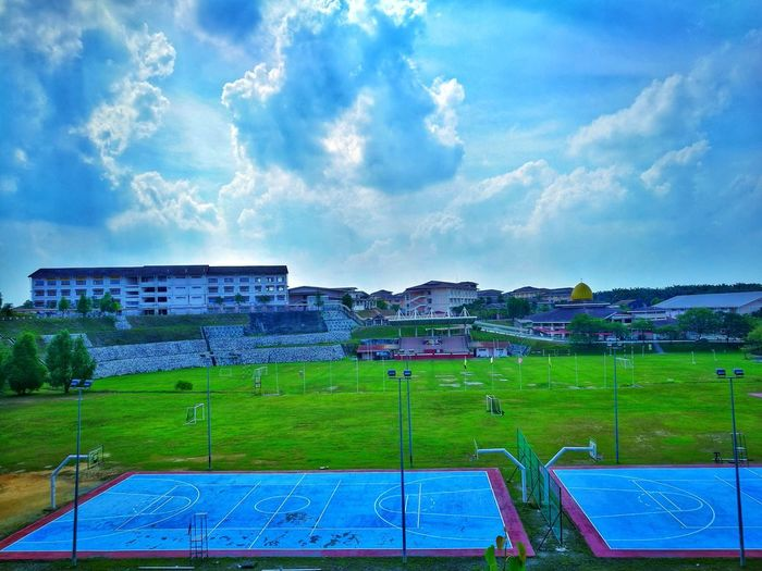 blue sky with greenery Green Cloud Blue Blue Sky Beauty In Nature Magnificent Soccer Field Stadium City Sport Playing Field Soccer Sky Grass Cloud - Sky