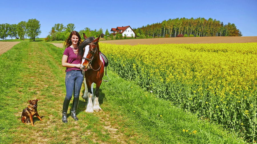 Dog And Horses Agriculture Canine Dog Dog❤ Domestic Domestic Animals Field Full Length Grass Horse Horse Photography  Land Landscape Nature Pets Plant Pony❤️ Togetherness Women