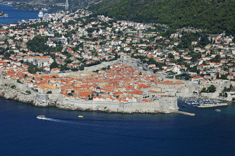 High angle view of townscape and sea in town