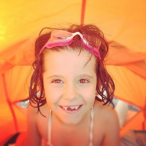 Holiday POV on Beach Under the Orange Tent whit Swimming Goggles Pink