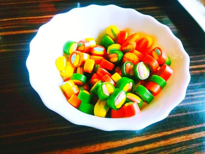 colorful sweets in a bowl Colorful Sweets Round Shape Round Sweets Food Food And Drink Fruit Freshness Healthy Eating Indoors  No People Day Indoors  High Angle View Table Still Life Close-up Chopped Sweet Food Ready-to-eat SLICE Plate Vegetable