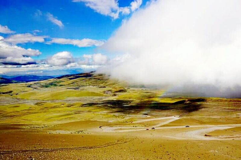 View of volcanic landscape against cloudy sky