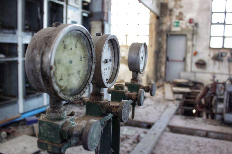 Close-up of rusty gauge in industry
