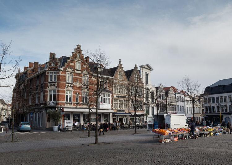 Buildings by street against sky at vrijdagmarkt