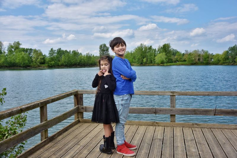Lake Brother & Sister Siblings Childhood Water Full Length Child Real People Lake Casual Clothing Togetherness Outdoors Cloud - Sky