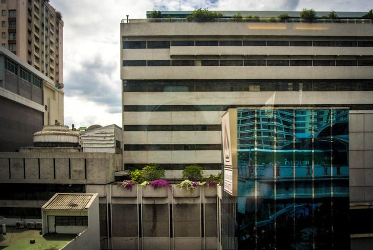 Battle Of The Cities Building Exterior Architecture Built Structure City Low Angle View Office Building Modern Window Building City Life Cloud - Sky Sky Hotel Travel Destinations Day Building Story Flower Tall - High Office Block Outdoors