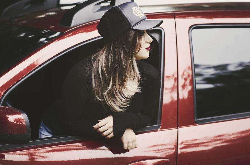 Woman looking through car window