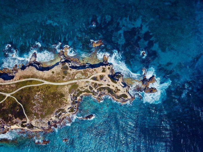 Top view of island in caribbean ocean.