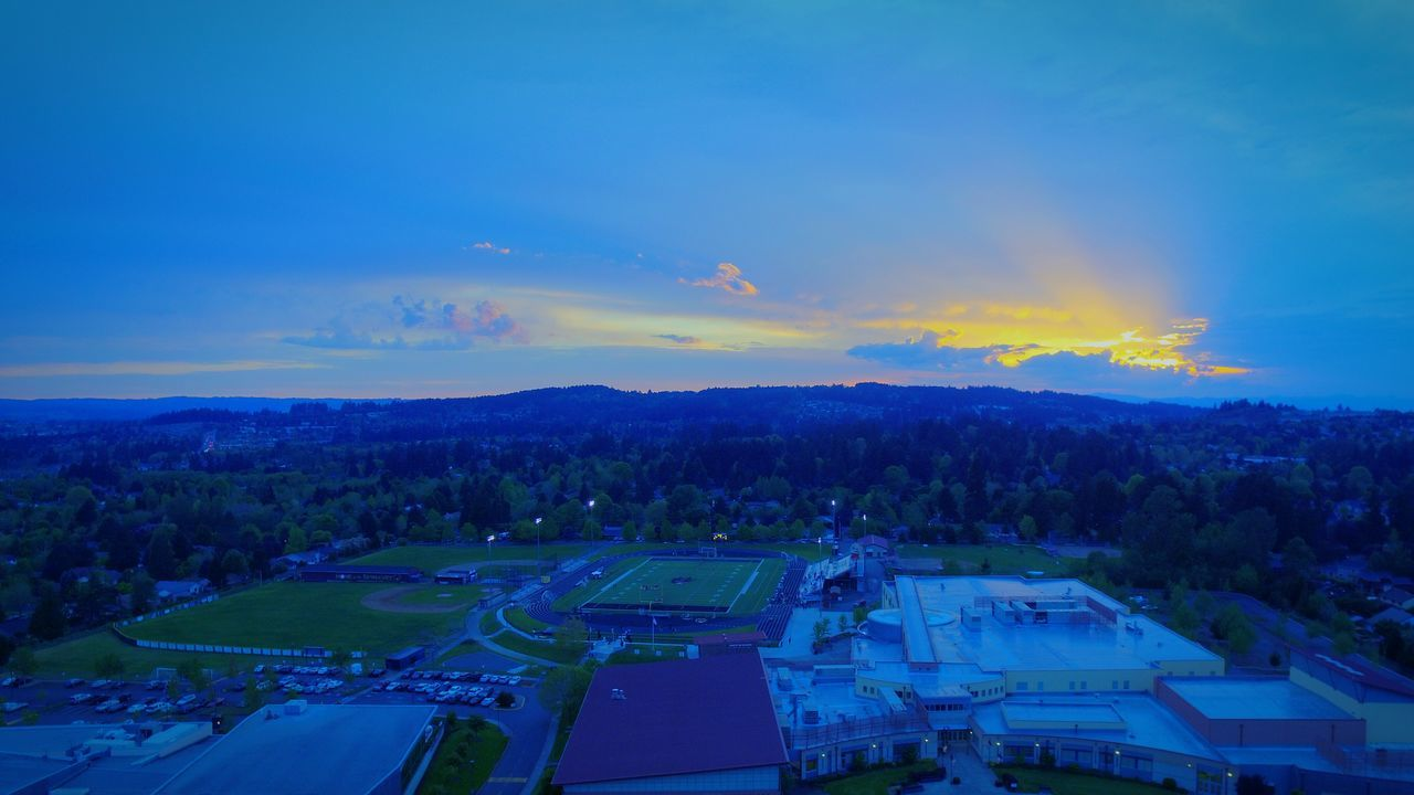 sky, cloud - sky, outdoors, building exterior, high angle view, no people, scenics, blue, architecture, built structure, nature, tree, sunset, day, beauty in nature, city
