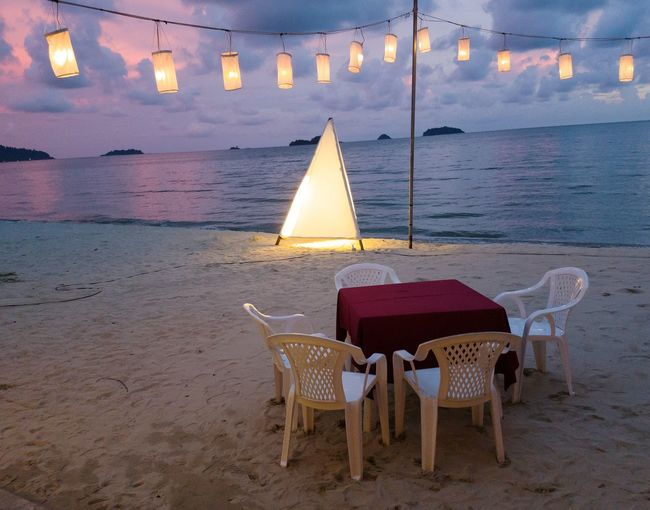 Dinner at Twilight, Koh Chang Island, Thailand. Beach Chair Sea Water Sand Outdoors No People Tranquility Illuminated Sunset Nature Sky Twilight View Tranquil Scene Beauty In Nature Outdoor Chair Twilight Sky Dramatic Sky Dinner Bulb Decorative Lights Lights In The Dark Dinner Time Dinner Tonight Dinner Table