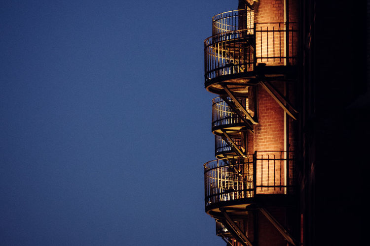 Low angle view of fire escape against clear sky