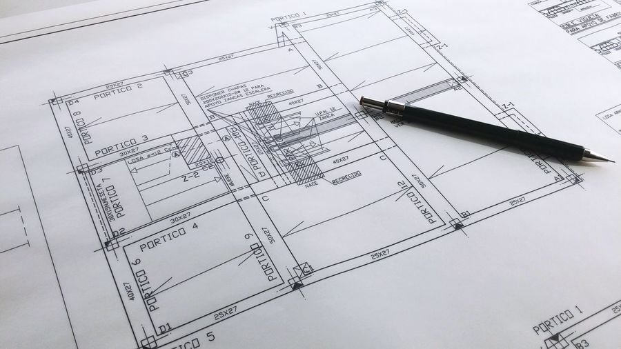 High Angle View Of Pen On Blueprint