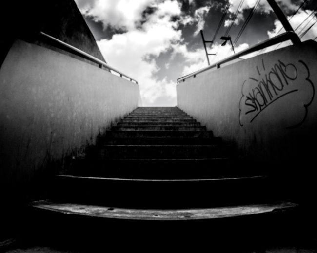 Low angle view of empty staircase against sky