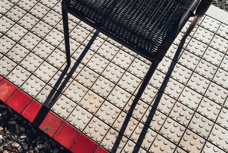 Color Redefining Red Minimal Light And Shadow Fine Art Streetphotography Abstract Exceptional Normalcy Simplicity Japan Retro Nostalgia Street Chair Tiled Floor Looking Down Black White Minimalism Broken Patterns Pattern High Angle View Tile Flooring No People Design Footpath Shape Day Paving Stone Square Shape Indoors  Geometric Shape Metal Stone Backgrounds Full Frame Sidewalk
