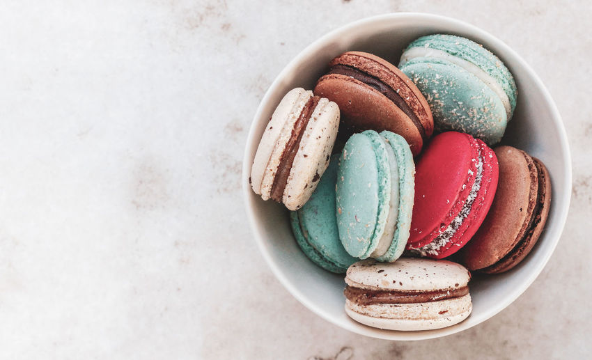 macarons in a bowl Macarons Blue Brown And Pink Macarons Blue Brown And Pink Macaroons From Above  negative space Copy Space Macarons In A Bowl Macaroons In A Bowl White Background Christmas Sweets Festive Sweets Festive Desserts Food Food Photography Macaroon Dessert Directly Above Candy Multi Colored Still Life Table Close-up Sweet Food Food And Drink