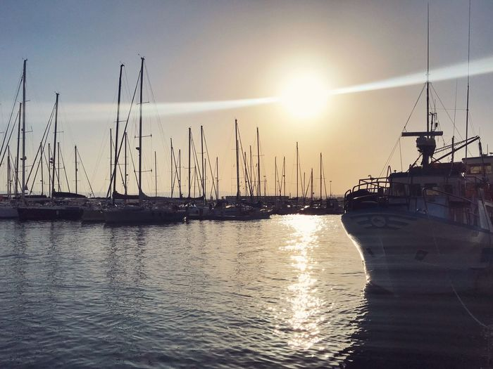 Sunset_collection Nature_collection Marina - Ortigia Sicily Sicilia Gianni Lo Turco Water Sky Sun Sunlight Sunset Reflection Nature Transportation Sea Beauty In Nature No People Silhouette Scenics - Nature Sunbeam Tranquility Waterfront Nautical Vessel Sailboat Tranquil Scene Lens Flare