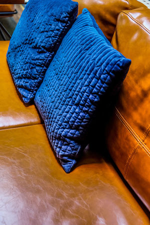 Close up detail of blue pillow on leather sofa Decor Interior Decorating Pillow Absence Art And Craft Black Color Blue Close-up Clothing Craft Cushions  Decoration Detail Furniture High Angle View Home Interior Indoors  Leather Leather Sofa No People Pattern Pillow Seat Sofa Still Life Table Textile Textured  Wood - Material